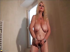Granny Dana (66) strips with the..