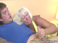 Mature granny tugging dick of..