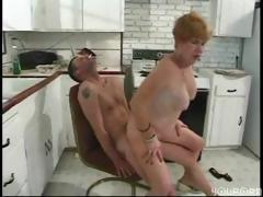 Busty mature redhead blows and..