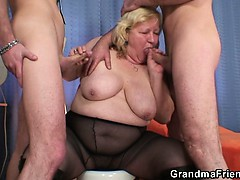 Huge titted grandma swallows two..