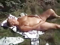 Nasty granny fingering outdoor...