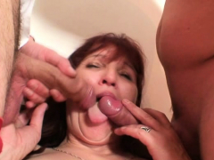Old mature woman swallows a..