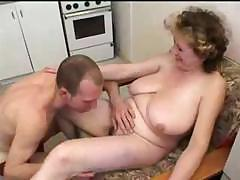 Busty mom gets a group orgy going..