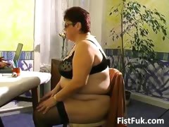 Busty mature fatty gets her old..