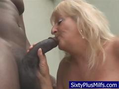 Dirty old granny sucking  a huge..